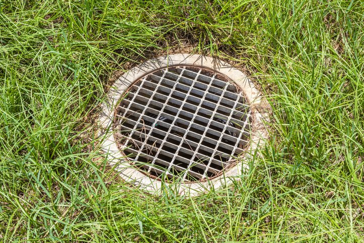 How to avoid yard drain flooding barker and sons for Yard drainage basin